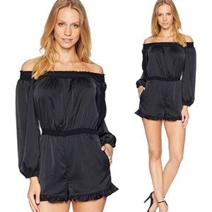New with tags Bebe off the shoulder satin romper